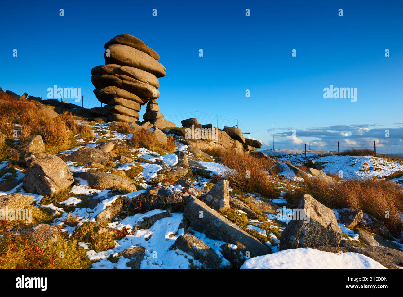 The rock formation know as the Cheesewrings stands high up on Bodmin Moor after snowfall - Stock Image