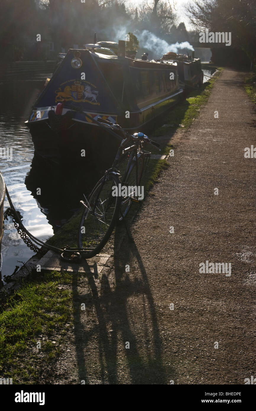 smoke leaving a narrow boat moored by a towpath on the Grand Union canal Rickmansworth Hertfordshire UK - Stock Image