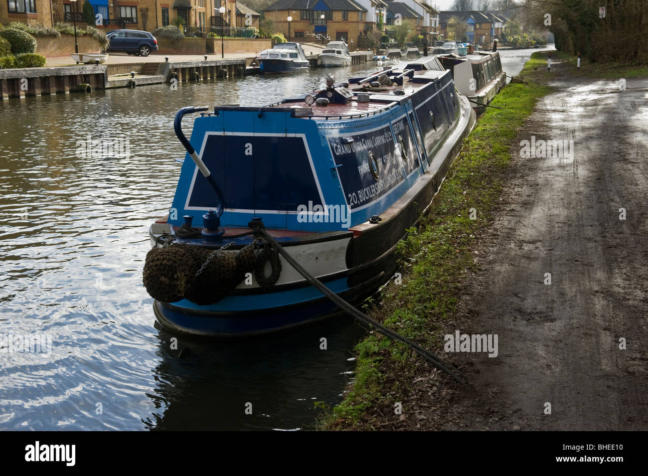 moored narrow boats by the towpath of the Grand Union canal near Harefield Middlesex West London UK - Stock Image