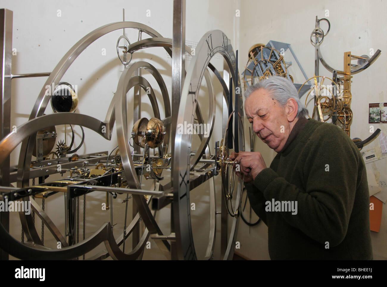Jean Kazes, master Swiss clockmaker with clock bound for Clochard, New York; Carouge, Geneva, Switzerland - Stock Image