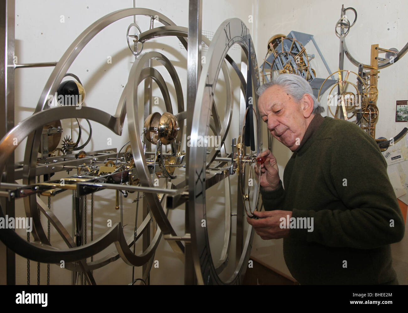 Jean Kazes, master Swiss clockmaker with clock bound for Clochard, New York, in his Carouge workshop, Geneva - Stock Image