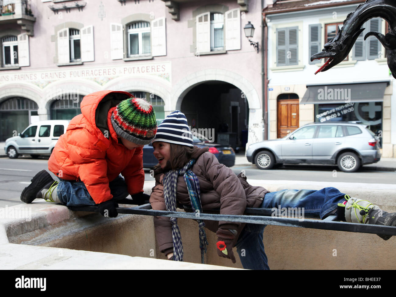 kids playing outside  winter, Carouge, Geneva, Switzerland Stock Photo
