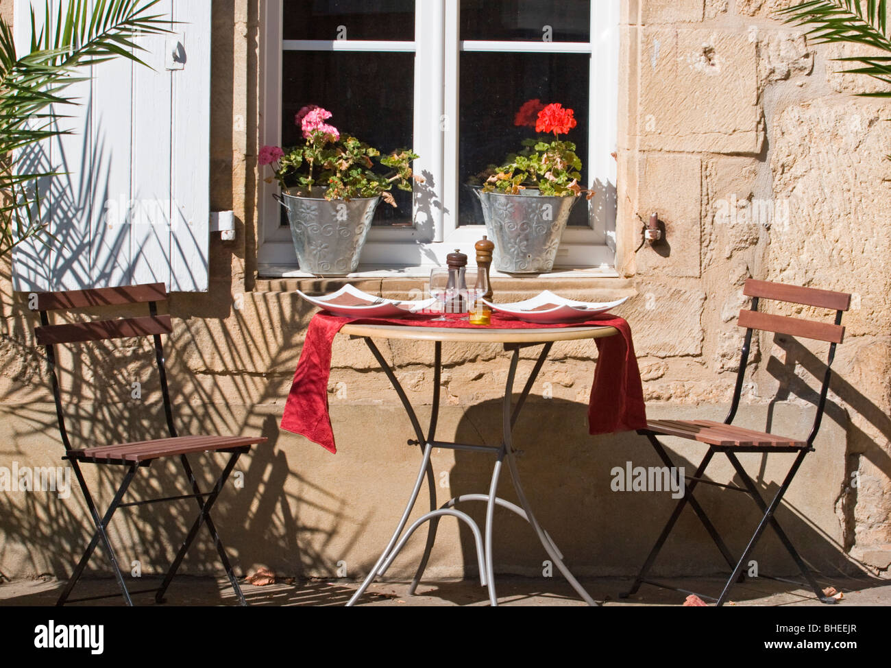A Charming Cafe Table For Two Outside The Restaurant La Flambee In Picturesque Medieval Village Of Domme Dordogne France