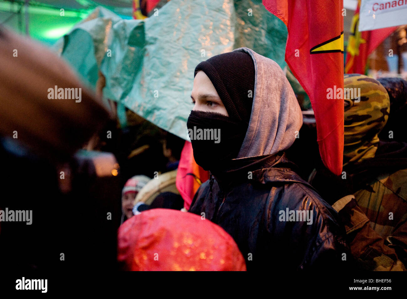 Masked anti Olympic protester on the opening day of the 2010 Vancouver Olympic games. February 12th, 2010. - Stock Image
