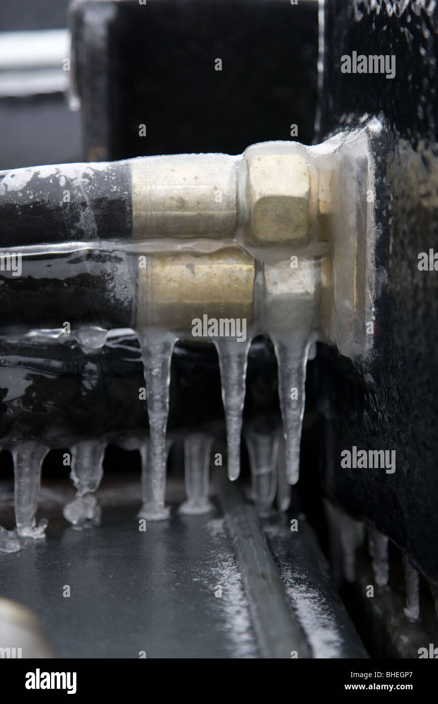 hydraulic hoses covered with ice on a truck - Stock Image