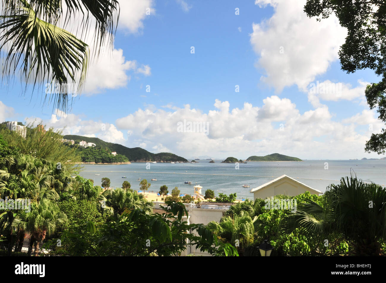 Blue sky, tree window view of the beach, safe bathing area, shark net and South China Sea shipping lane, Repulse - Stock Image