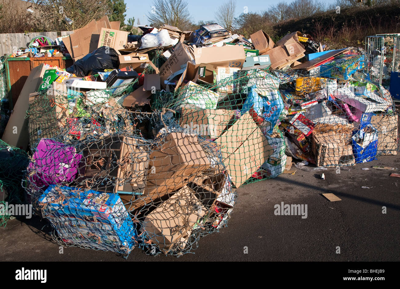 Cardboard waste at recycling collection station in car par UK - Stock Image