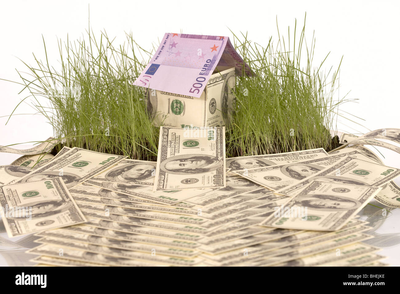 symbolical house from banknotes of dollars and euro Stock