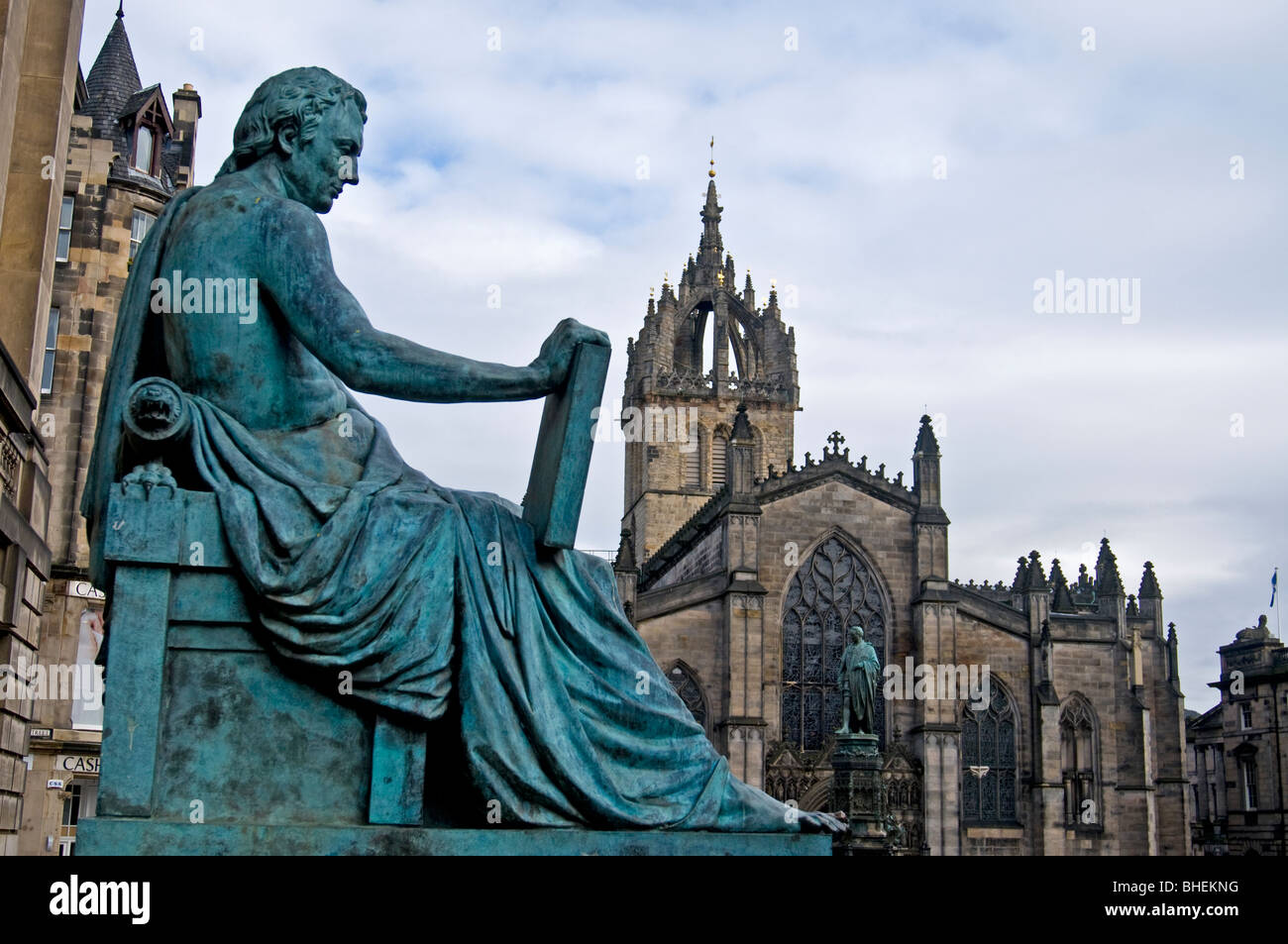 The statue of David Hume on the Royal Mile with St Giles Cathedral Beyond, Edinburgh Lothian Region Scotland  SCO Stock Photo