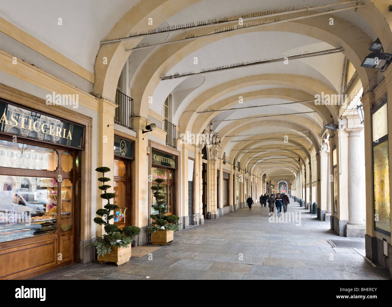 Cafe and shops in a portico on the Piazza San Carlo in the historic centre, Turin, Piemonte, Italy - Stock Image