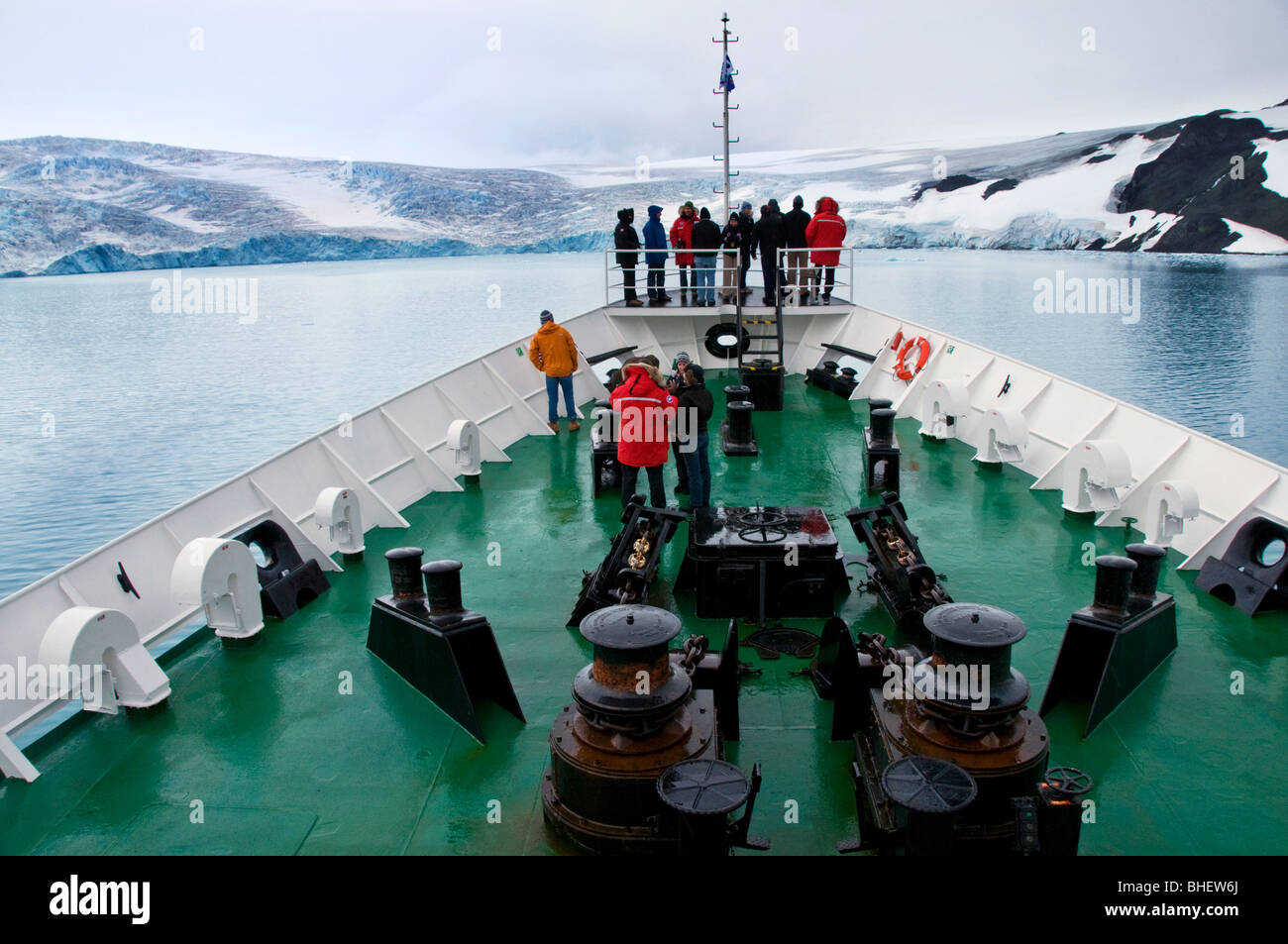 Tourists on an expedition boat as it approaches King George Island off the Antarctic Peninsula - Stock Image