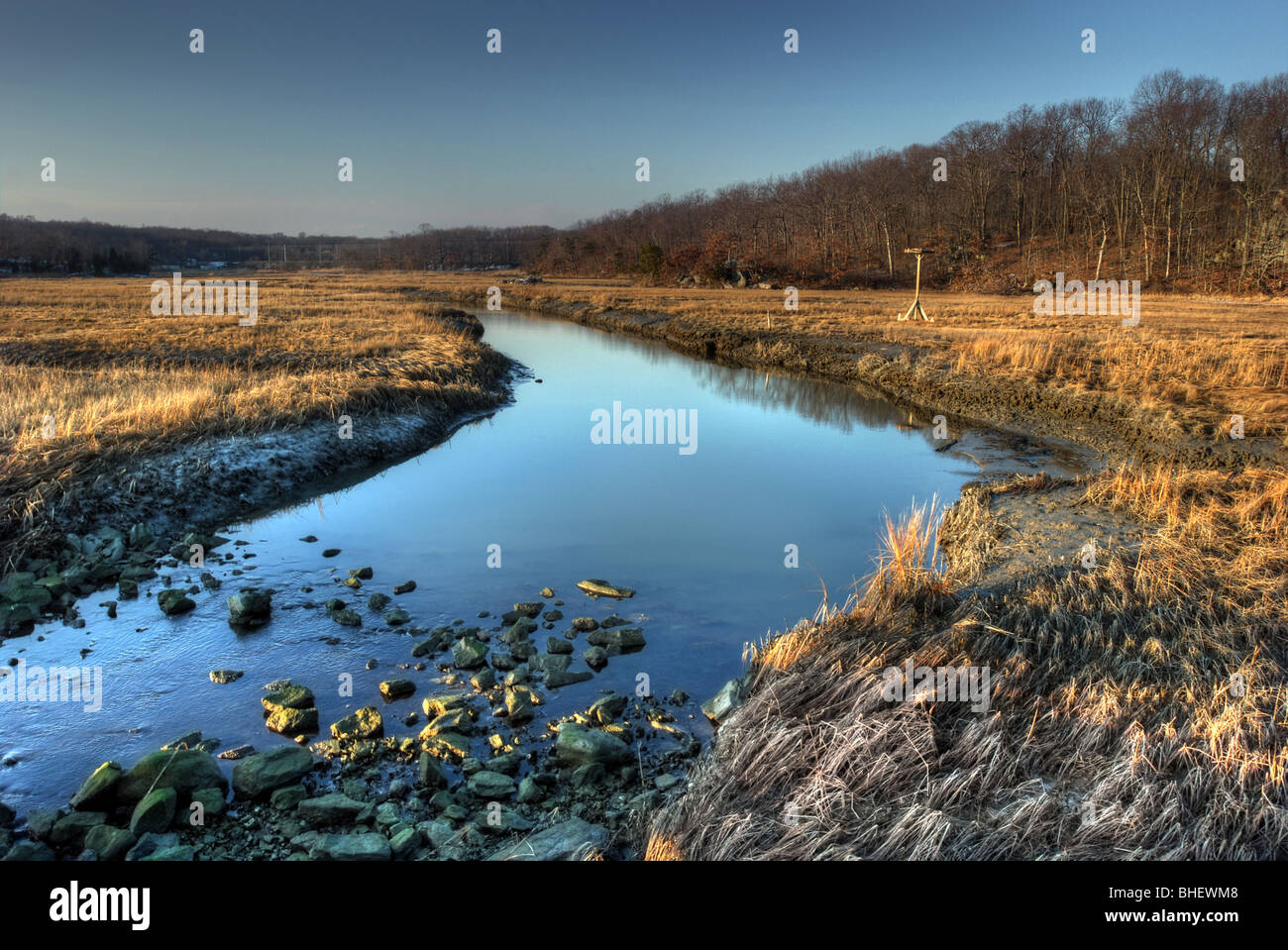 A protected marshland in Branford Connecticut USA with an Osprey platform that allows the native birds to nest and - Stock Image