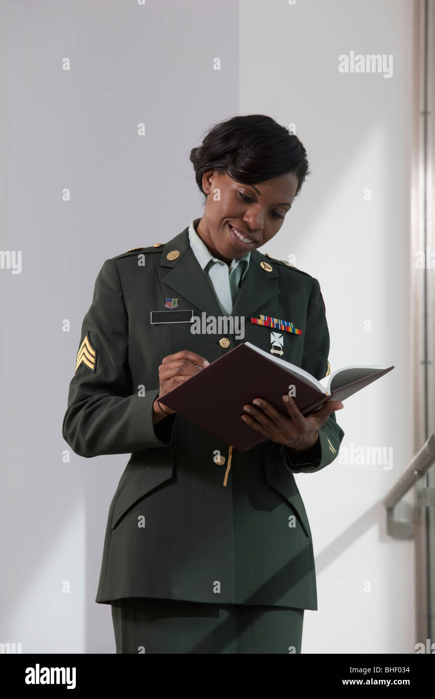 Female doctor of US army writing in a diary - Stock Image