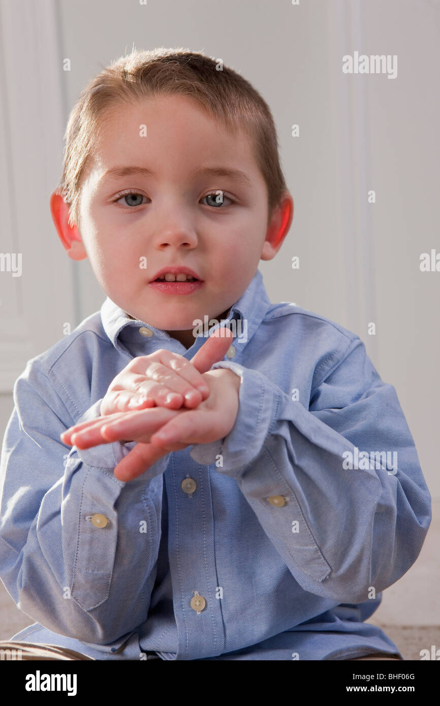 Boy signing the word 'English' in American Sign Language - Stock Image