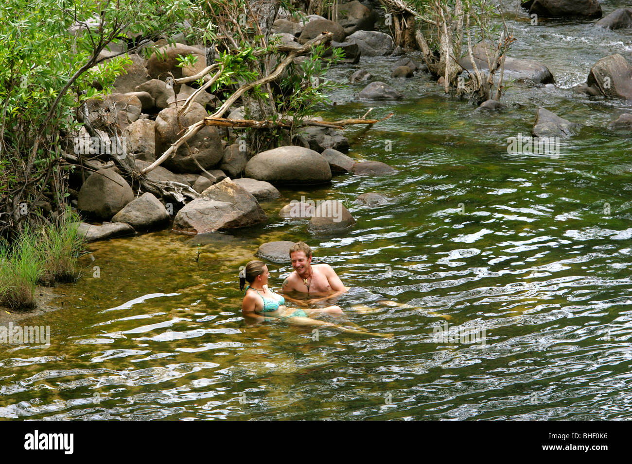 A couple enjoys the water of a rock pool in the escarpment of Nitmiluk National Park, in Arnhem Land, northern Australia. Stock Photo