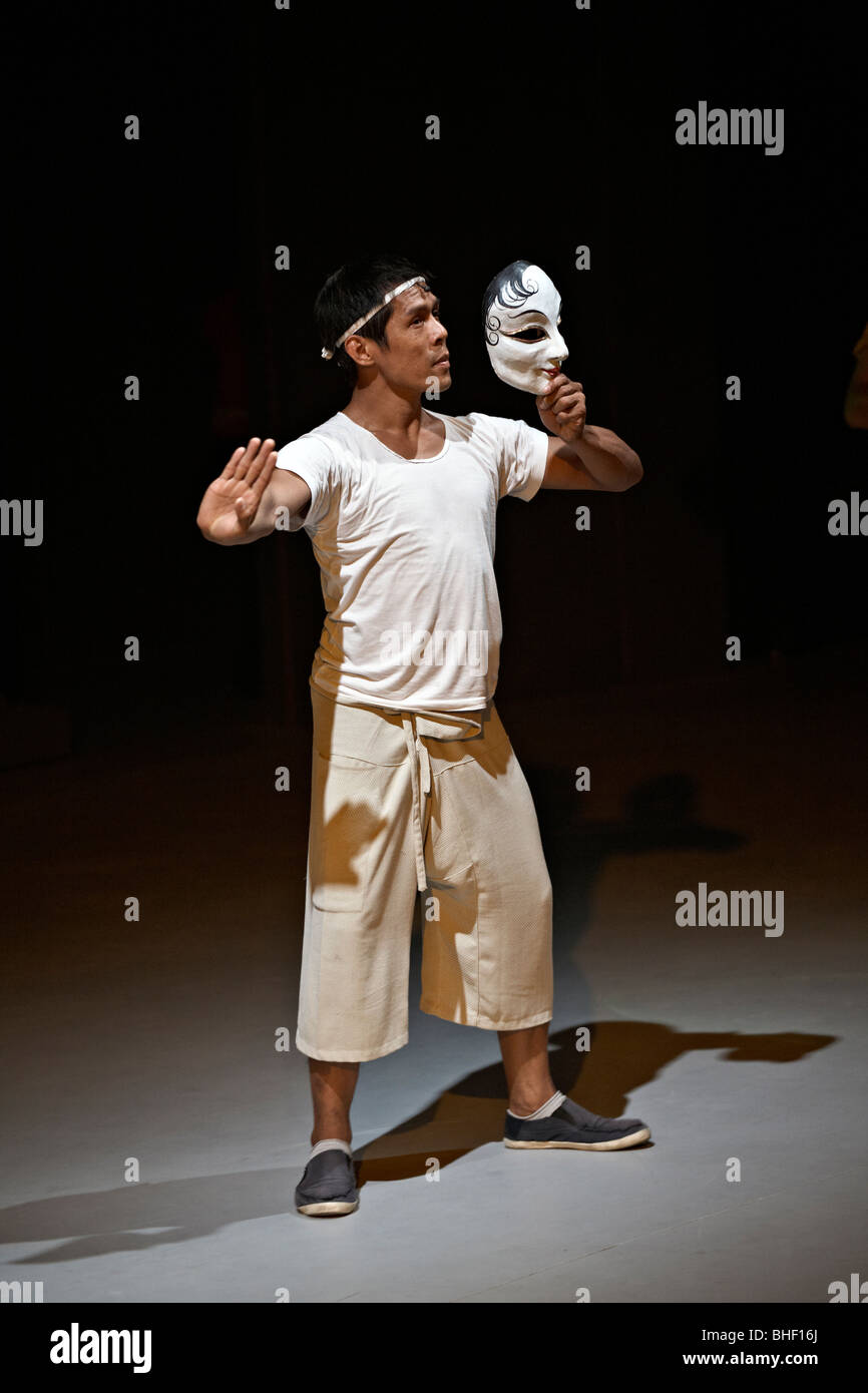 Thai actor rehearsing on stage with mask. Thailand S. E. Asia - Stock Image