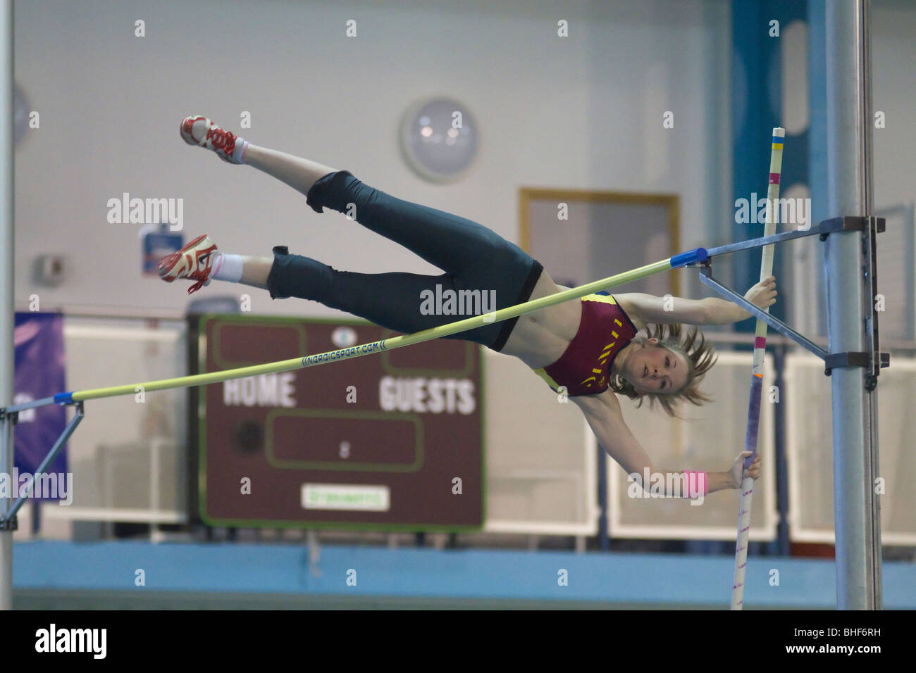 Female doing the pole vault. - Stock Image