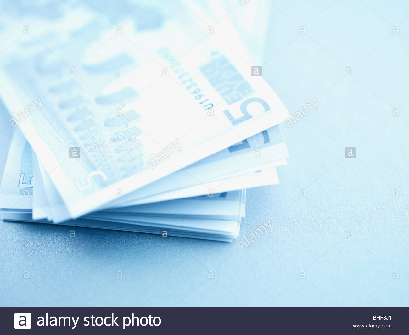 Stack of five euro bank notes - Stock Image
