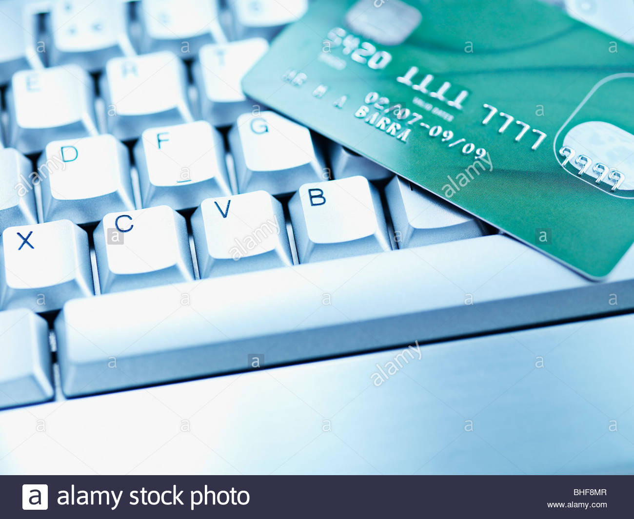 Computer keyboard and credit card - Stock Image