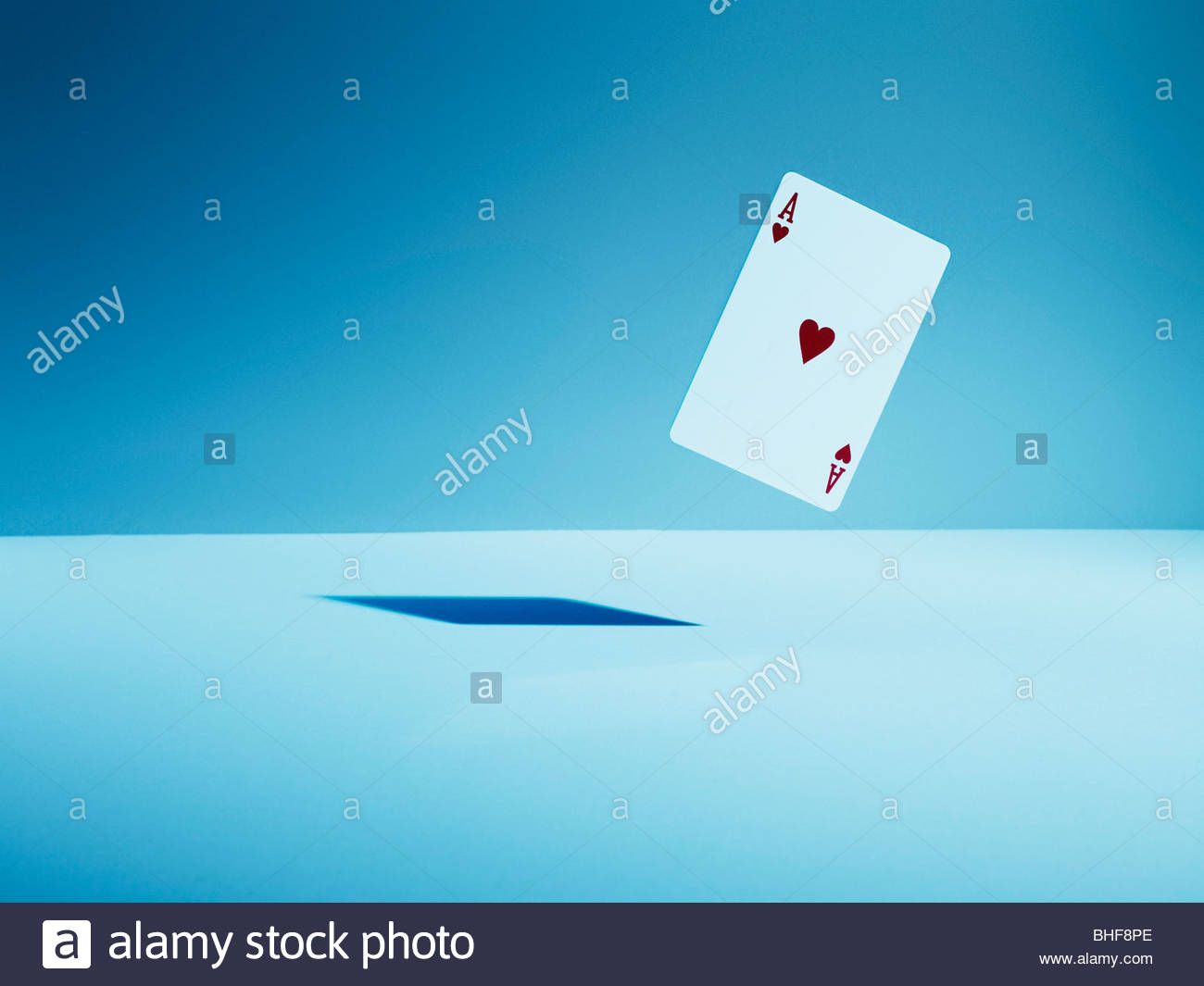 Ace of hearts playing card in mid-air - Stock Image