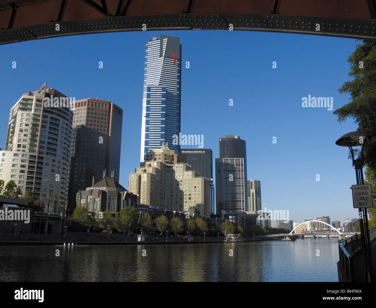Melbourne's Docklands precinct on the Yarra River framed by the Princes Street Bridge - Stock Image