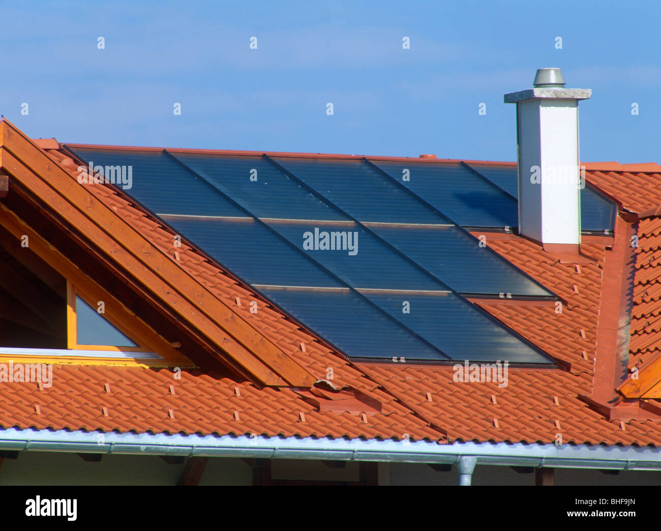 Solar panels in roof of house - Stock Image