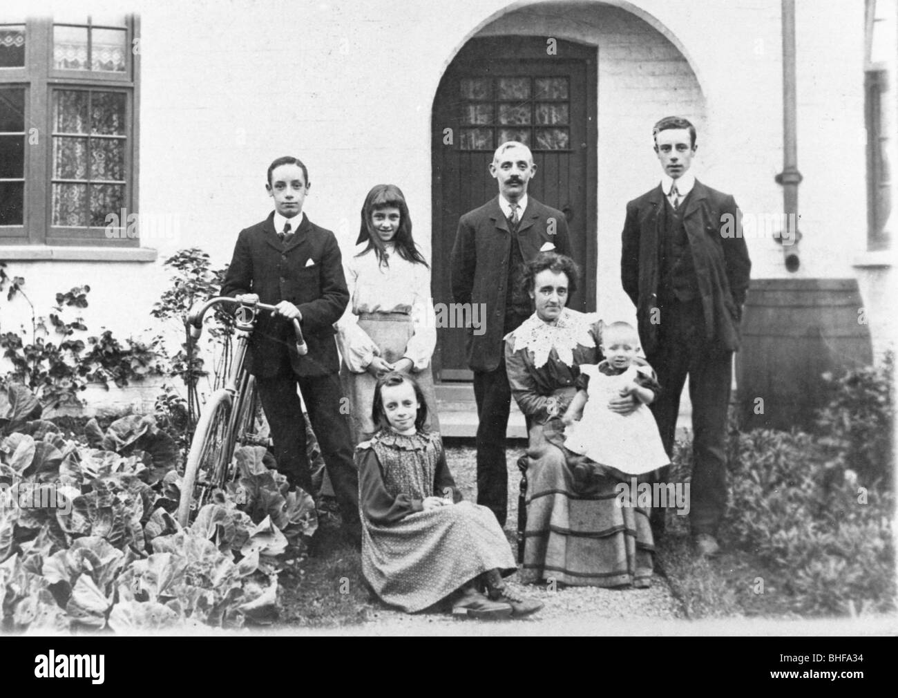 A family group on the New Easwick houses, York, Yorkshire, 1905. - Stock Image