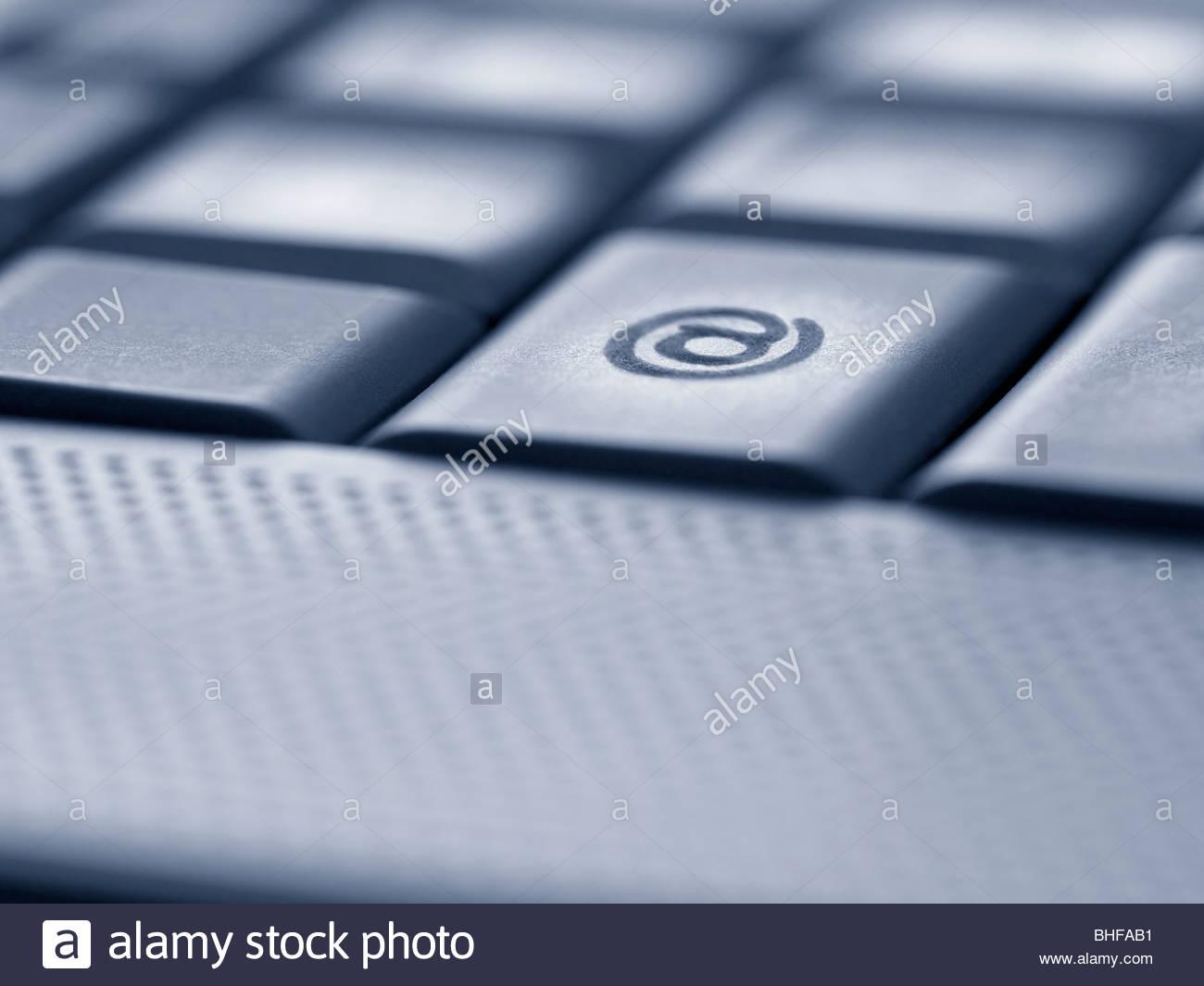 Close up of the at symbol key on computer keyboard - Stock Image