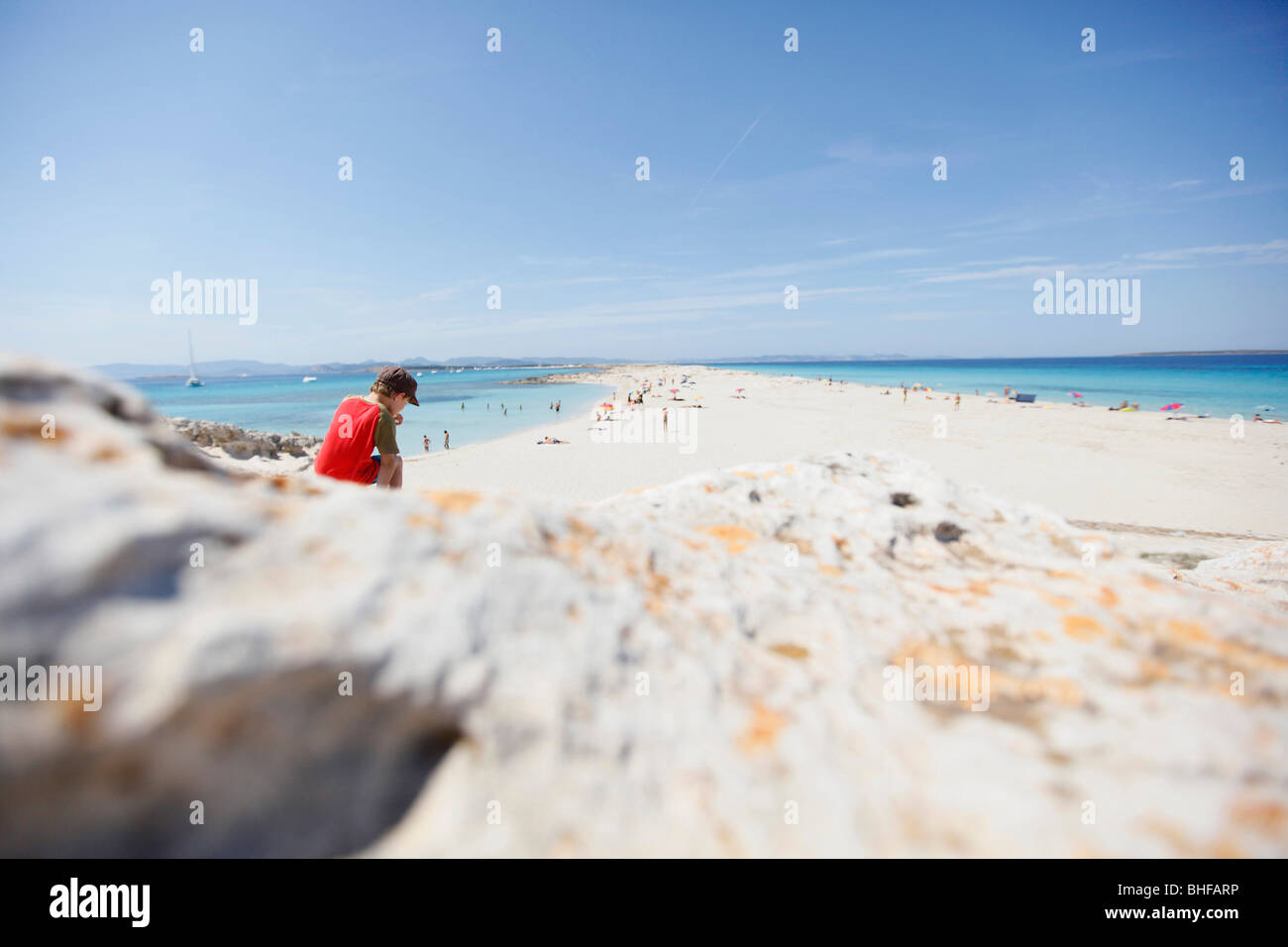 Boy on the beach, les Illetes und Llevant beach, Formentera, Balearic Islands, Spain - Stock Image