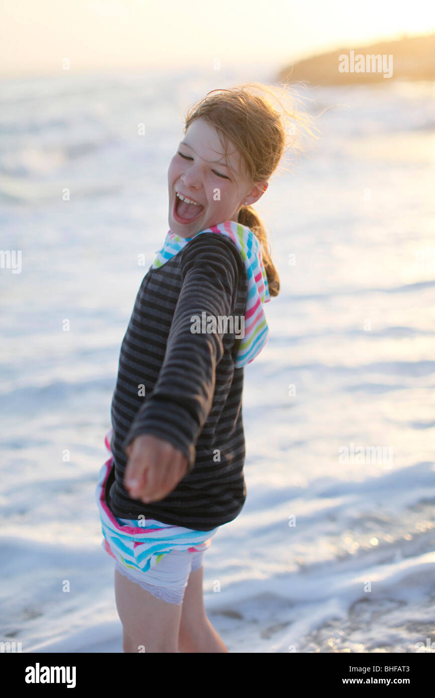Girl on the beach in the evening light, laughing, Es Arenals, Formentera, Balearic Islands, Spain - Stock Image