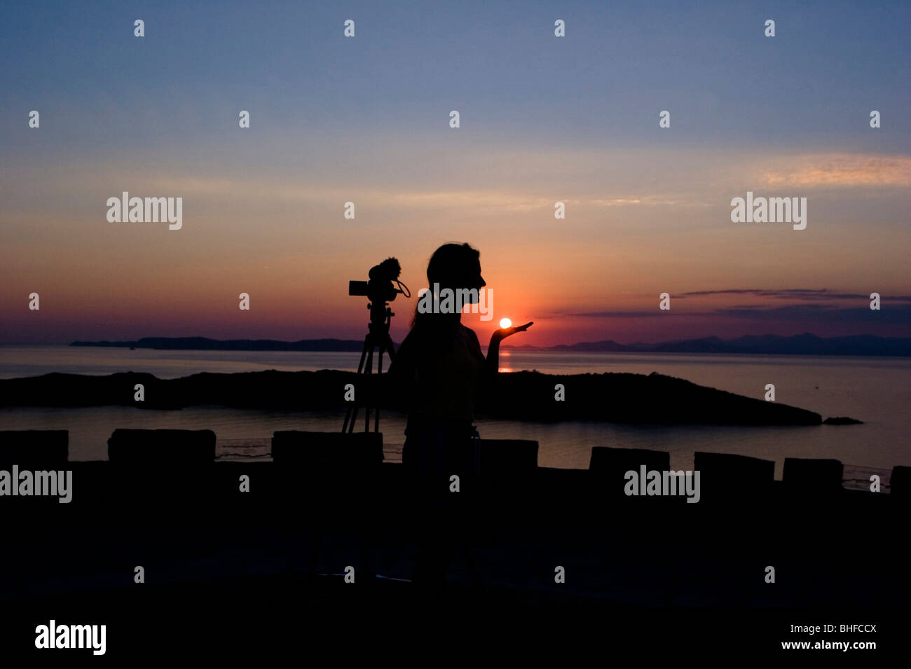 Young woman at a fort at sunset, Port Cros, France, Europe - Stock Image