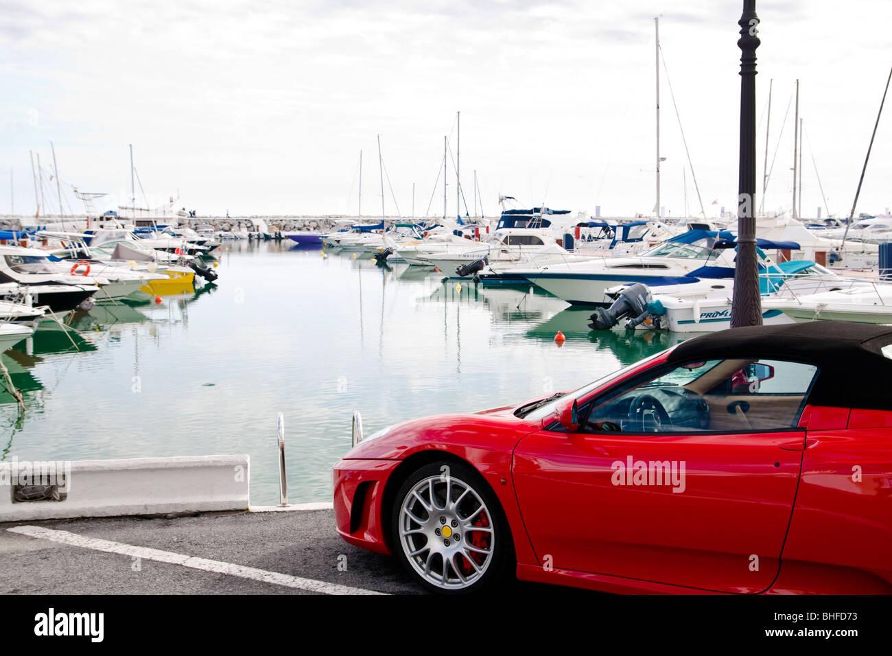 Closeup of car at luxury yacht port Puerto Banus, Marbella - Andalusia, Spain - Stock Image