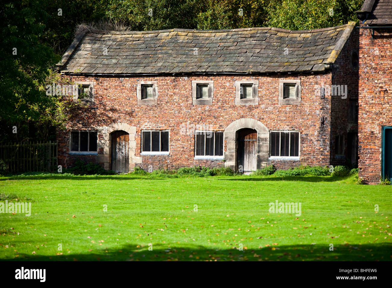 Barn cottages in the grounds of Dunham Massey Hall - Stock Image