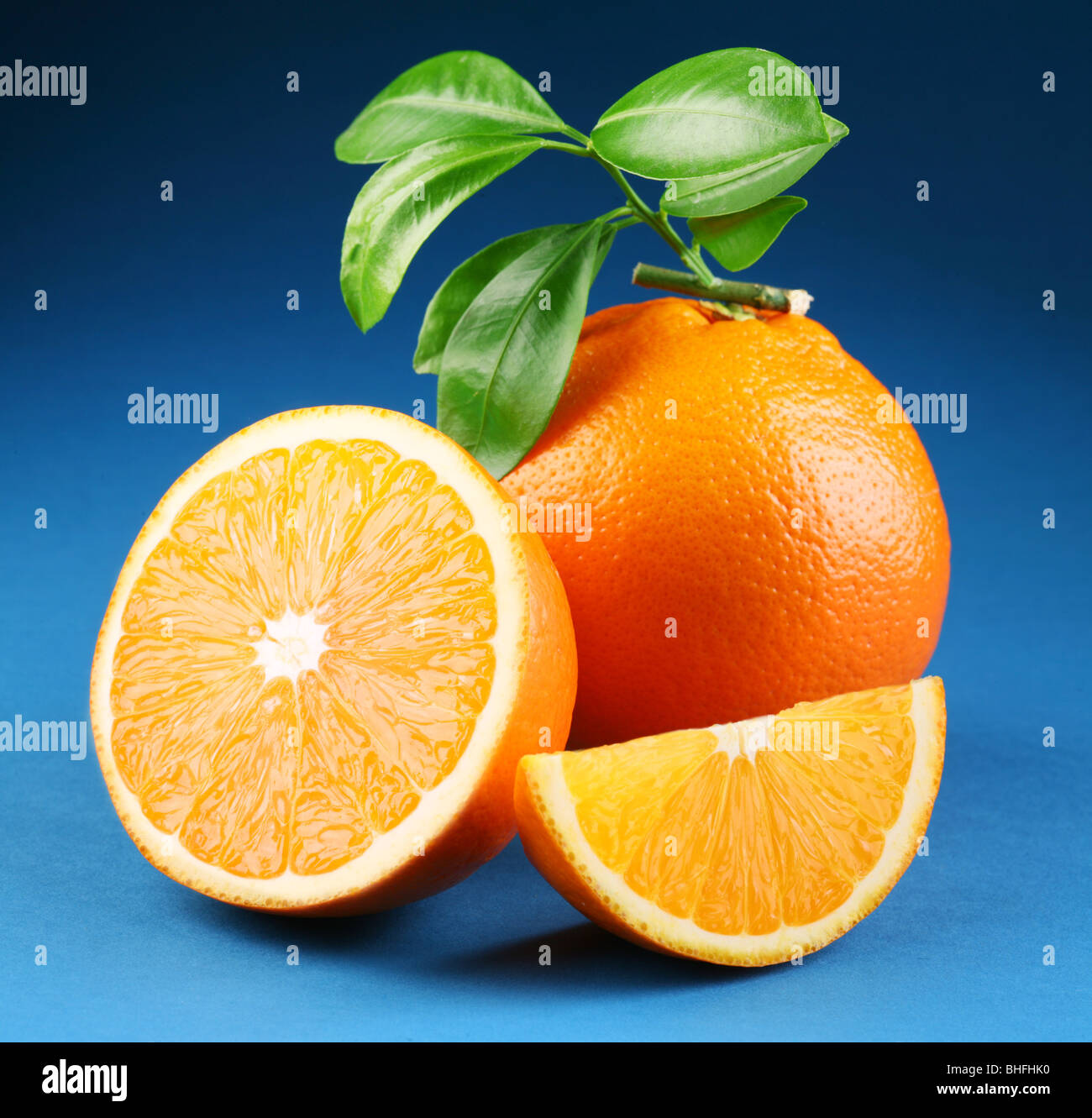 Ripe orange on a blue background - Stock Image