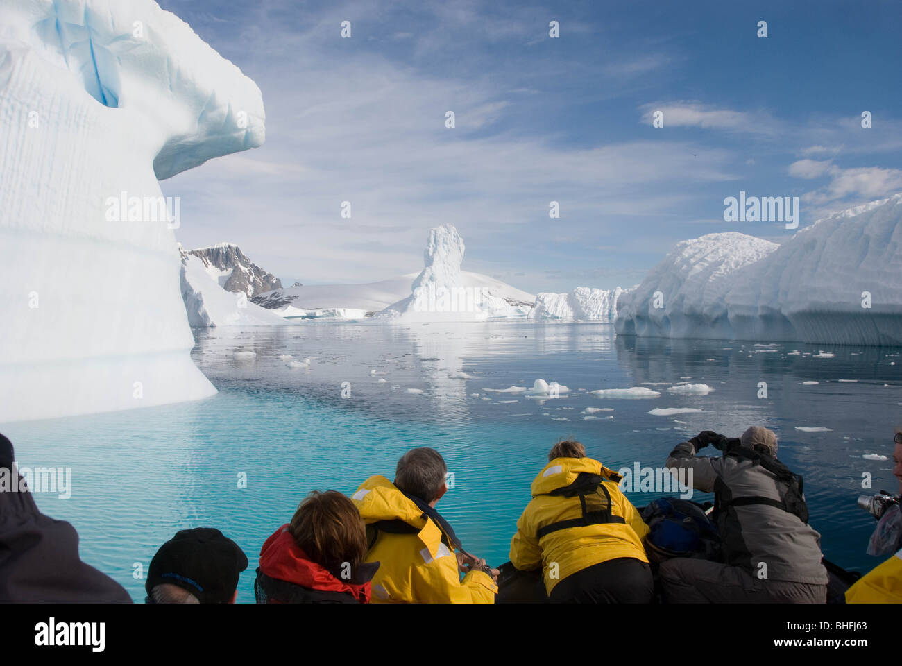 Tourist enjoy a zodiac cruise amongst grounded ice bergs near Pleneau Island, Antarctic Peninsula. - Stock Image