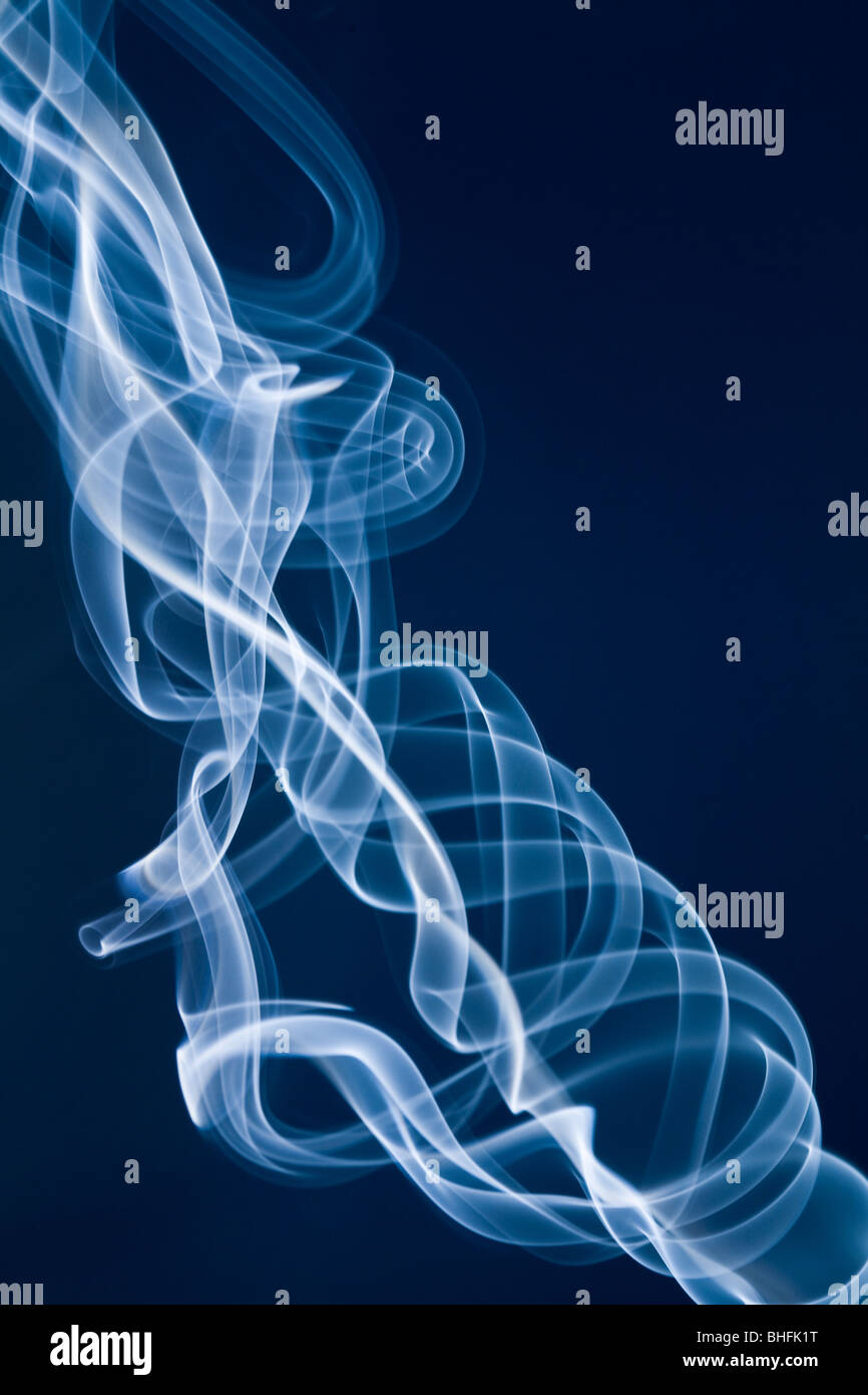 Jet of white smoke against a blue background Stock Photo