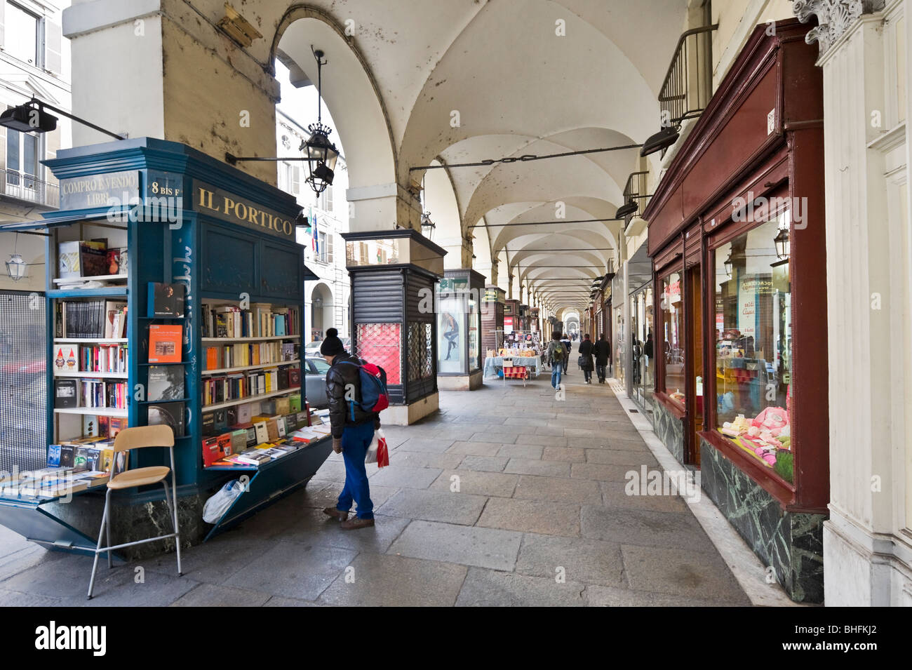 Secondhand book stall and shops in a portico along the Via Po in the historic centre, Turin, Piemonte, Italy - Stock Image