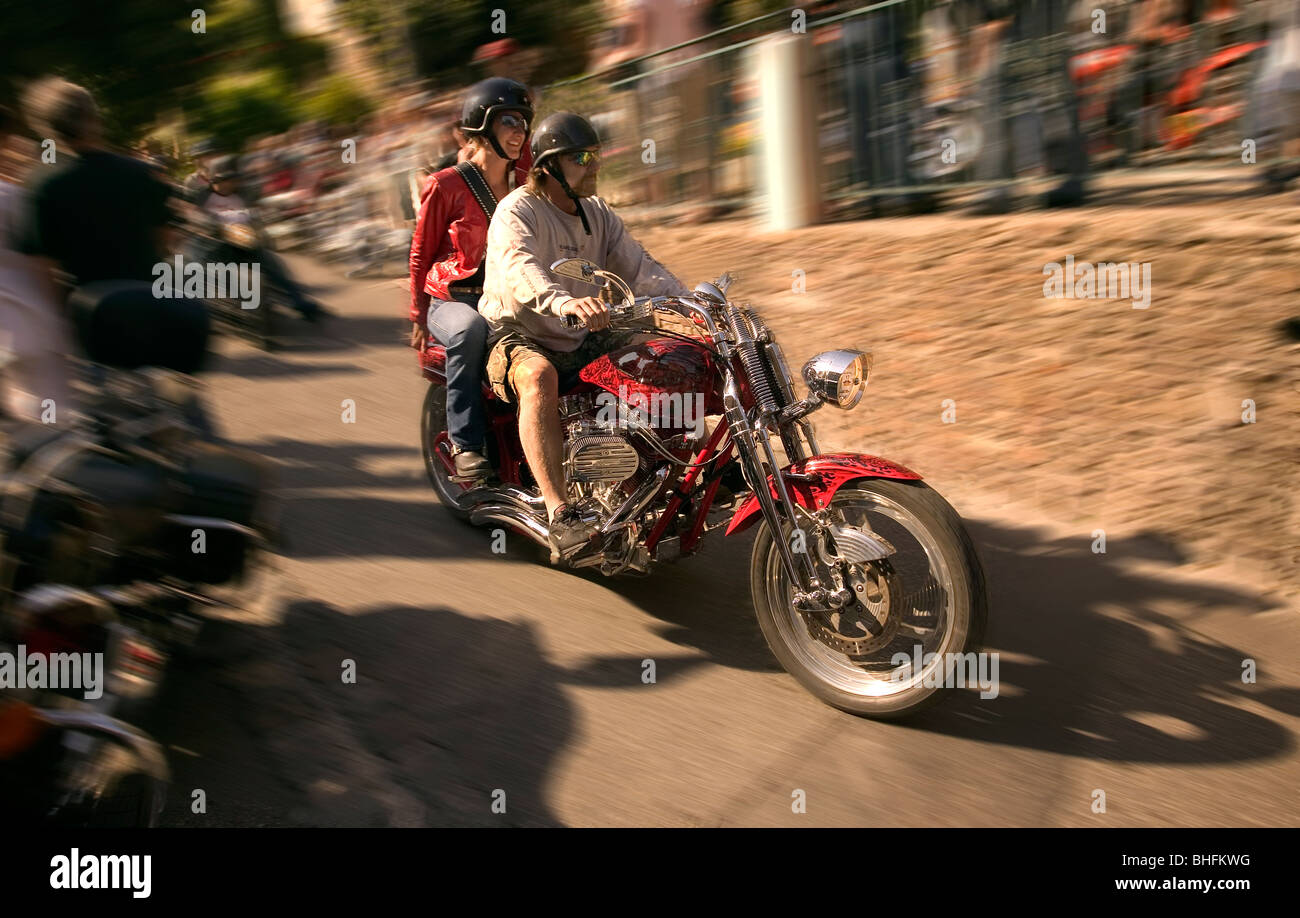 Riding a chopper motorcycle at speed. - Stock Image