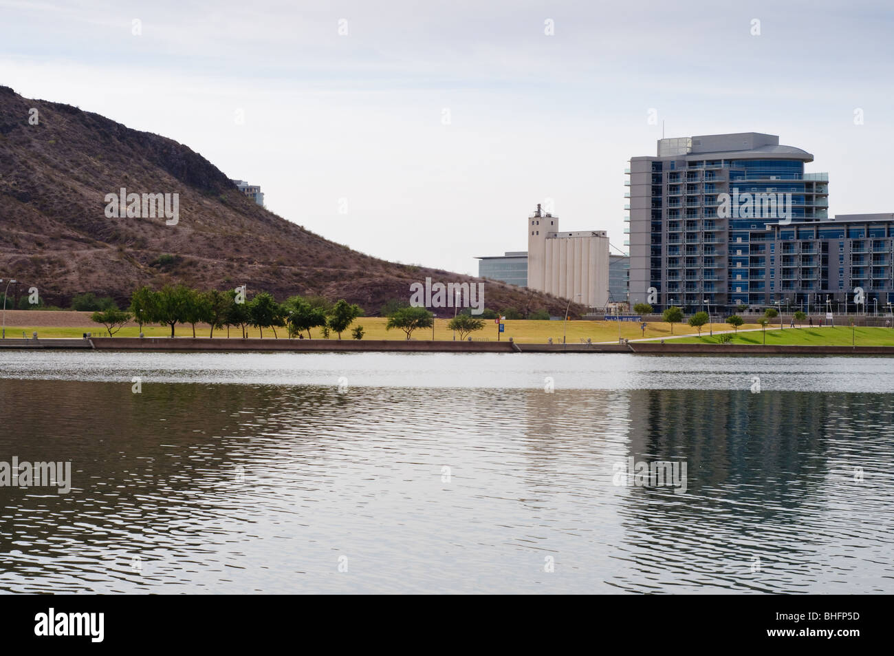 The old Hayden Flour Mill, new office buildings, mountain and paths on Tempe Town Lake, in Tempe, Arizona - Stock Image