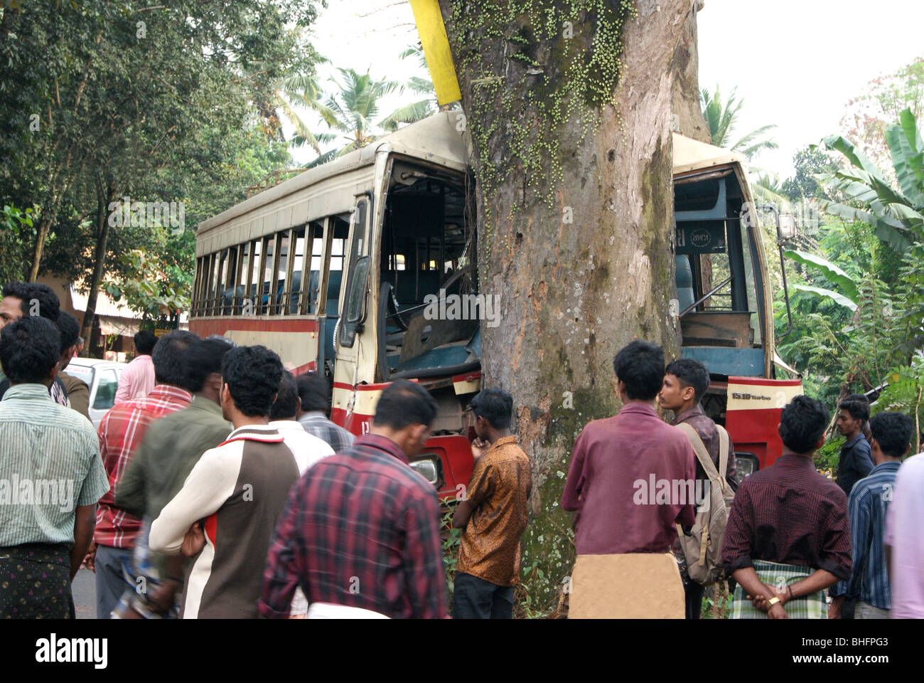 Bus Accident in Kerala.Bus hardly hit on the big tree.Large crowd assembled on the Spot. - Stock Image
