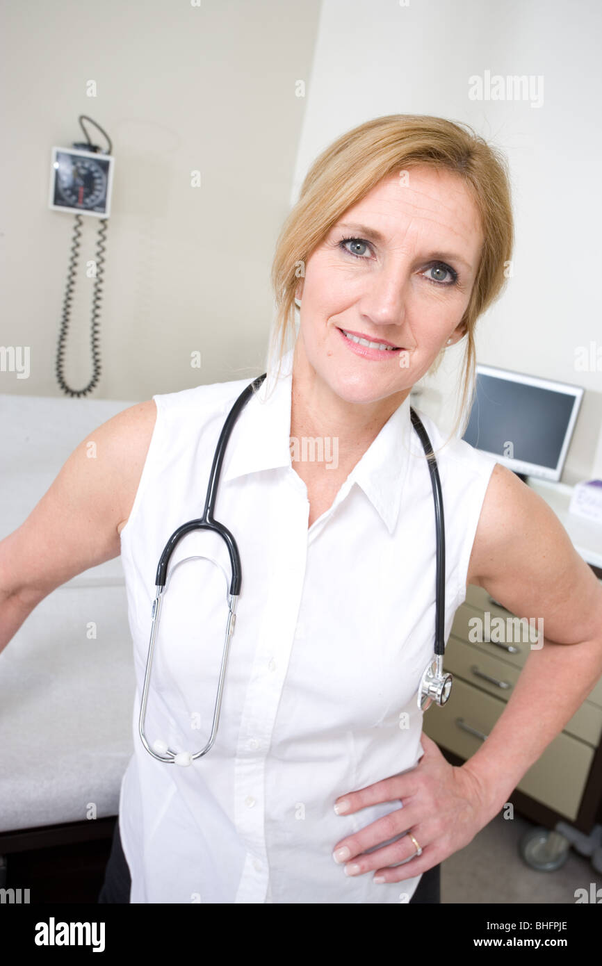 Female nurse or doctor in her medical exam room. - Stock Image