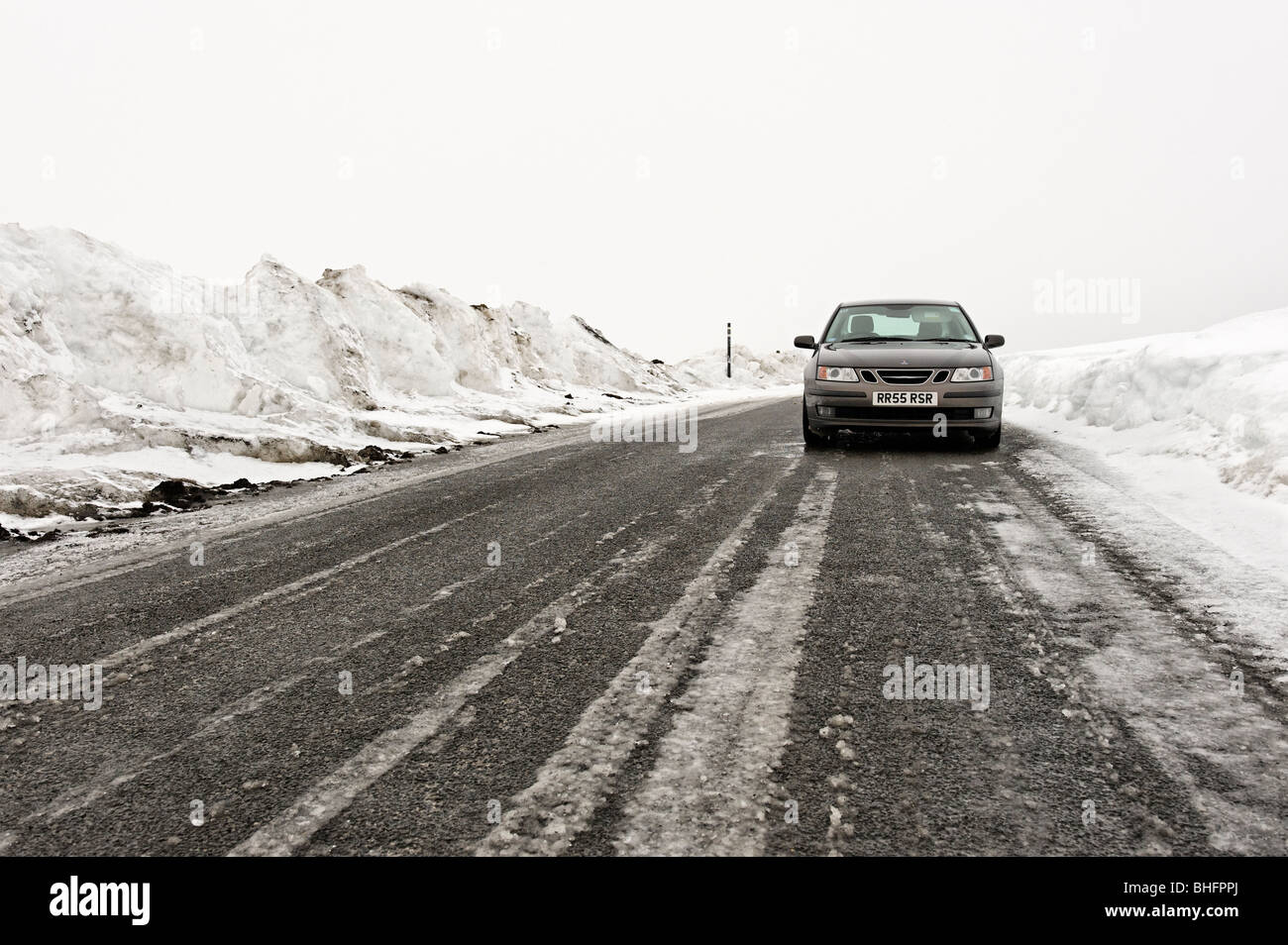 Winter road in North Pennine road cleared of snow - Stock Image