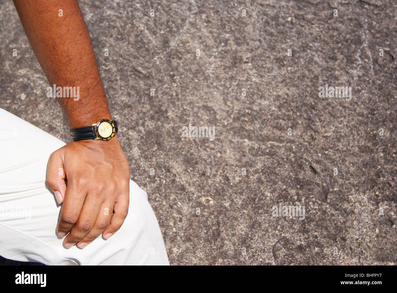 Stylish Hand in blurred Hard Rock background - Stock Image