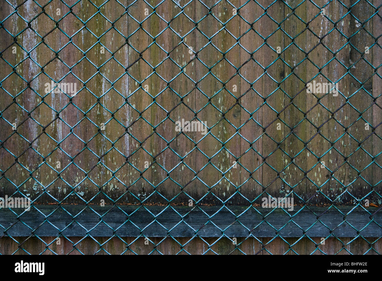 An old chain-link fence. - Stock Image