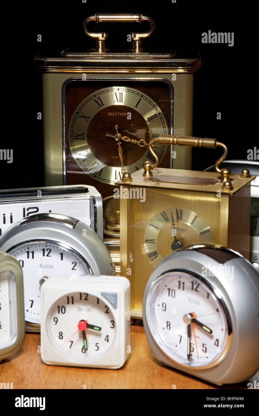 A collection of assorted clocks. - Stock Image