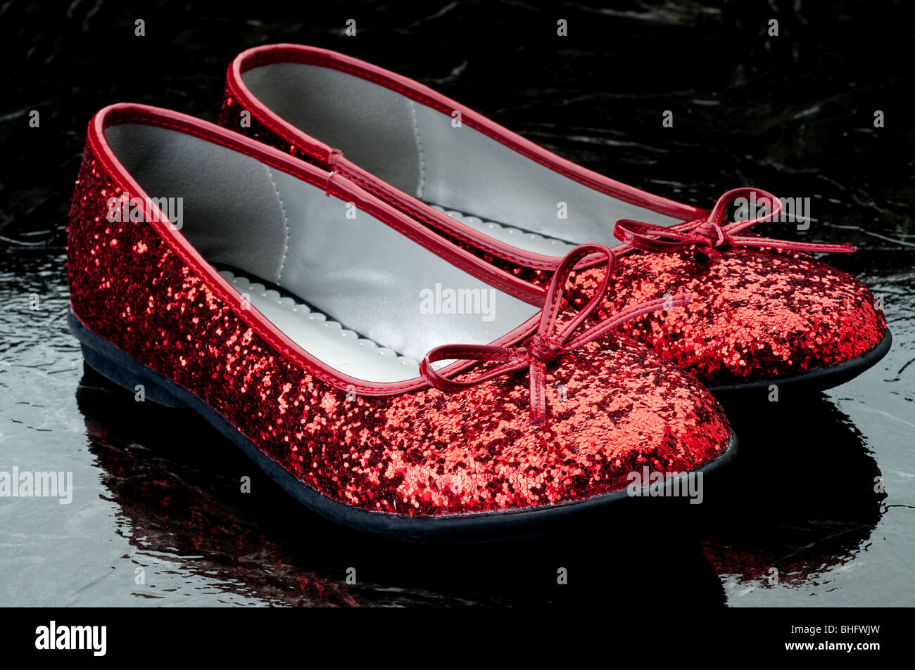 c519ac9337c Horizontal image of sequined red slippers on dark tile Stock Photo ...