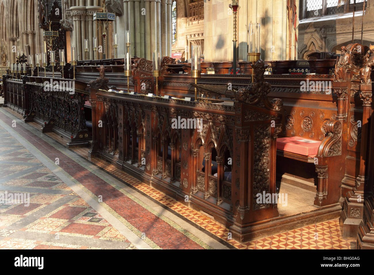 Beautifully carved Choir Stalls in Lichfield Cathedral formed from hardwood and the skill of long past craftsmen. Stock Photo