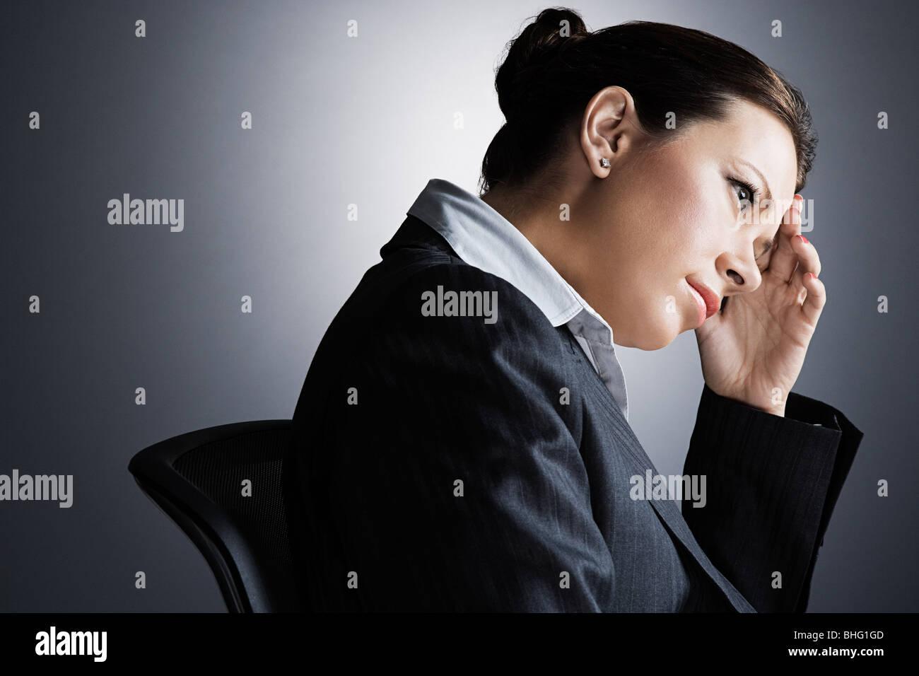 Stressed businesswoman - Stock Image