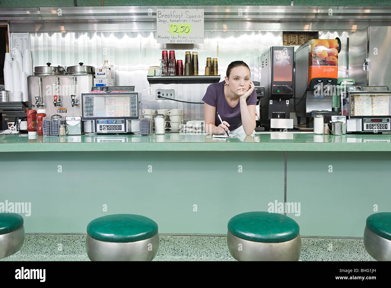 Bored waitress in a diner - Stock Image