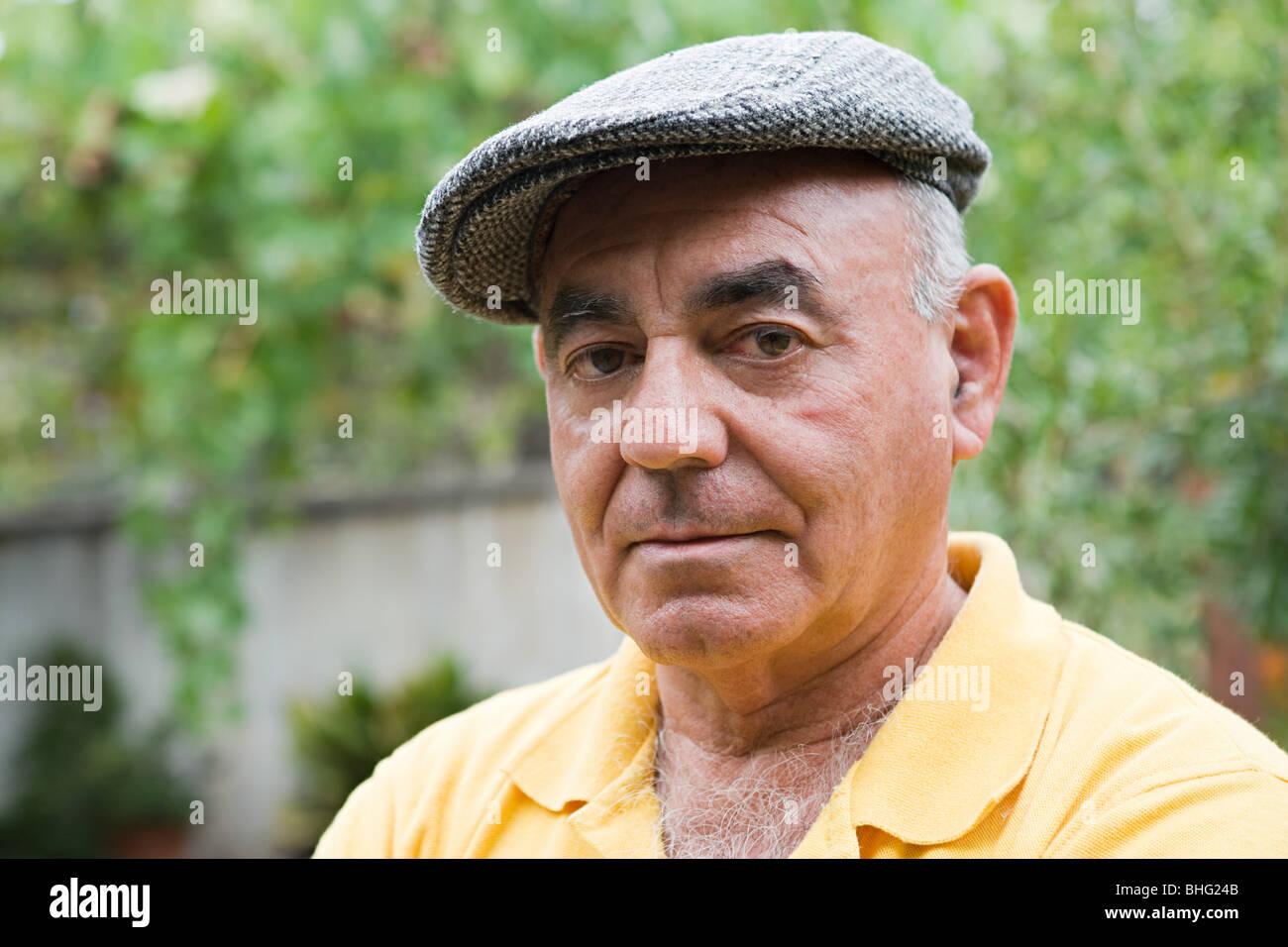 fb5bc207cea5b Man Wearing Flat Cap Stock Photos   Man Wearing Flat Cap Stock ...